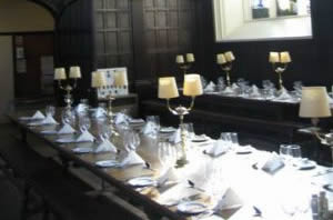 "the dining room set for ""high table"" at one of Oxford's colleges."